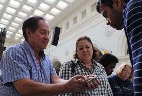 "Gerry and Nancy Ocampo show the vein-like quality on a rock he brought back from his travels. ""I thought it was a fossil like algae or something like that,"" said Gerry, of Bridgeview. Surya Rout identified the vein-like quality as the rock-forming mineral feldspar during the Field Museum's first Identification Day."