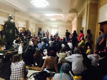 Participants watch a speaker at Tuesday's sit-in. / megan k. rauch / MEDILL