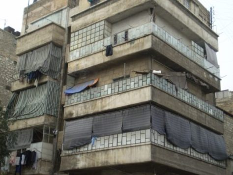 Crudely screened balconies in Aleppo, Syria Image