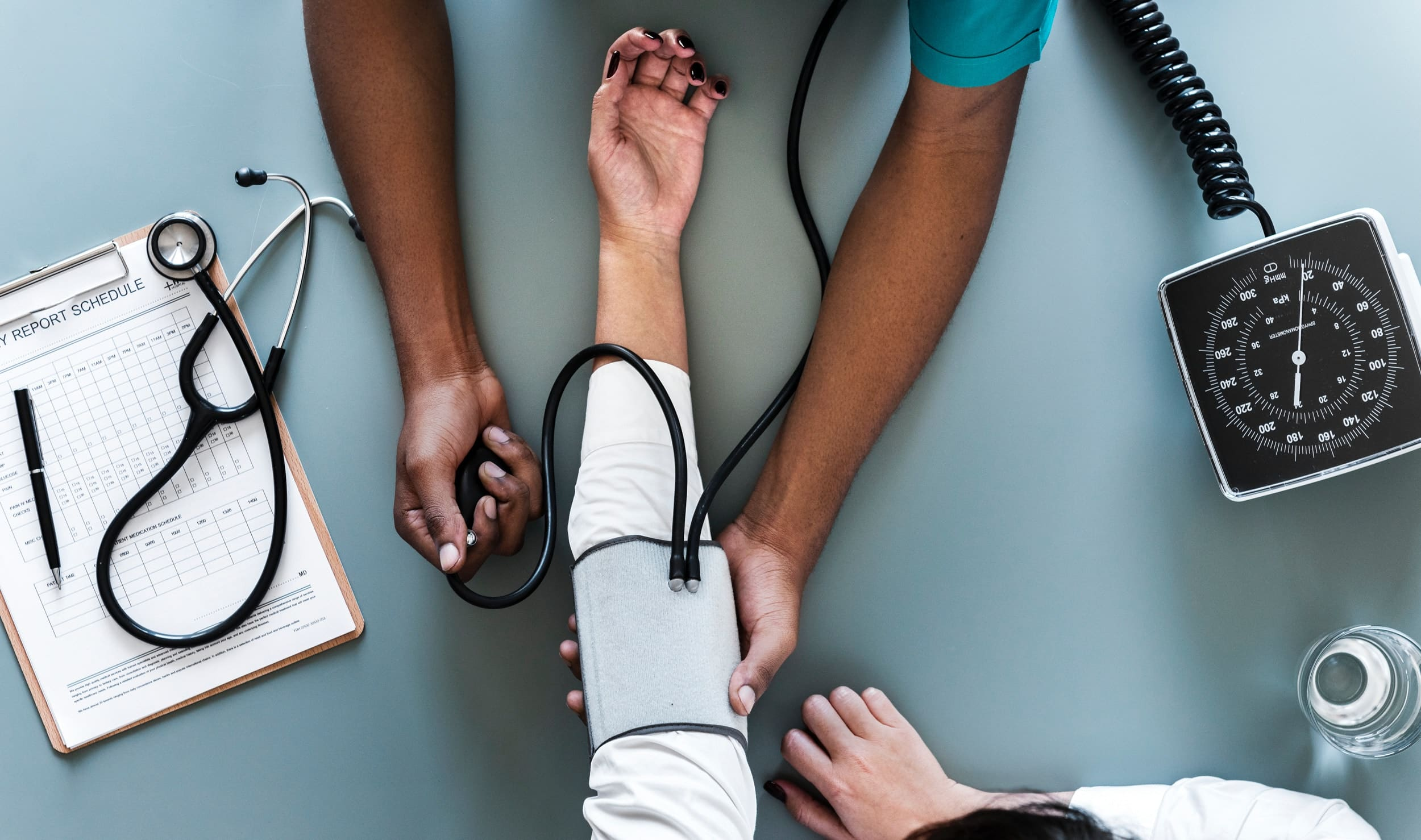 Medical staff checking vitals of a patient