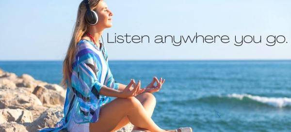 listen anywhere you go, woman at the beach meditating