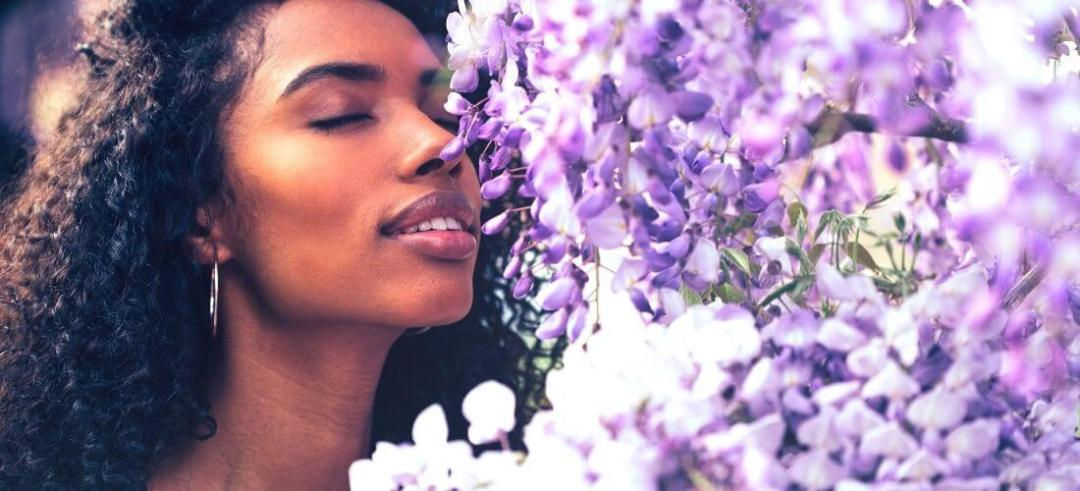 personal development woman smelling flowers