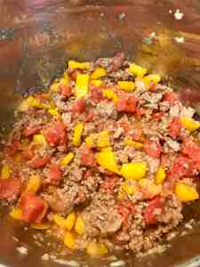 Ground beef with pepper, tomatoes and onions.