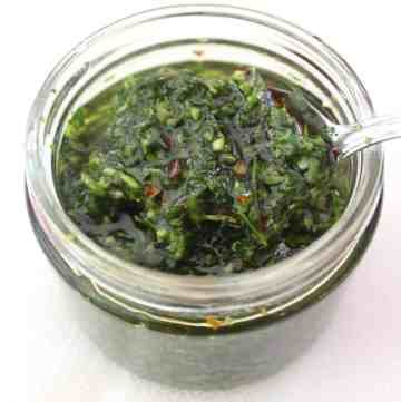 Argentinian Chimichurri sauce served in a glass jar.