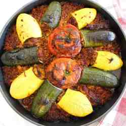 Mediterranean Casserole with stuffed zucchini, stuffed yellow squash and stuffed tomatoes