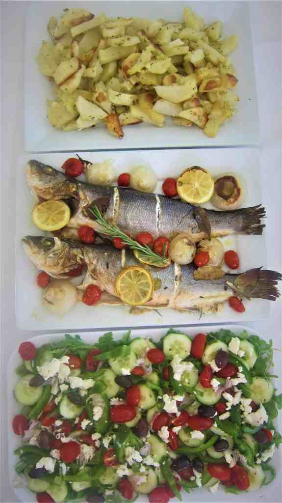 Baked Mediterranean Branzino or Sea-Bass served with an arugula/greek salad and roasted potatoes