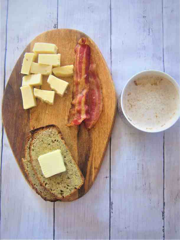 Almond Flour, Flaxseed, Cheese Keto Bread - toasted slices served with butter, gruyere cheese, bacon and latte.