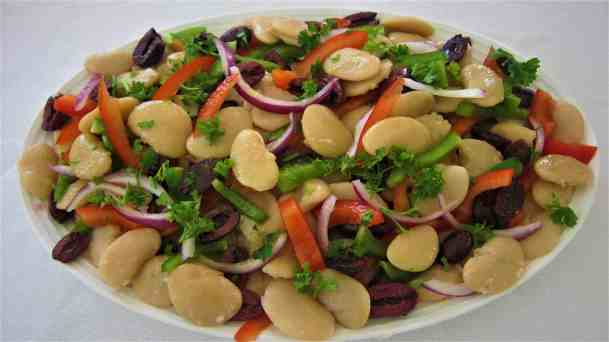 Mediterranean Jumbo Lima Beans Salad - showing a plate with butter beans, peppers, onion, olives and parsley
