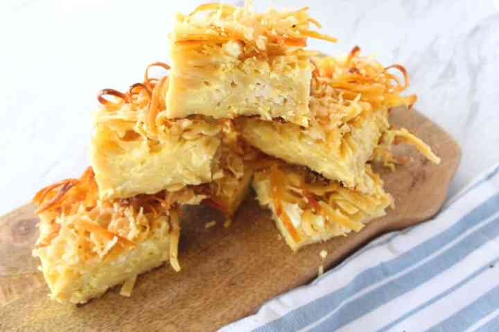 Baked Fettuccine Casserole with feta cheese, eggs, milk and butter. This casserole is called Pastiço in Albania. Picture shows slices of this casserole over each other.
