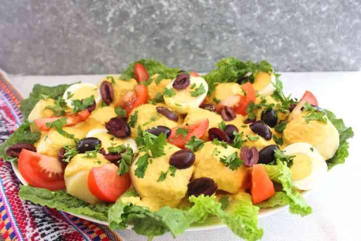 Platter with Bolivian Papas a La Huancaina, potatoes in peanut sauce.