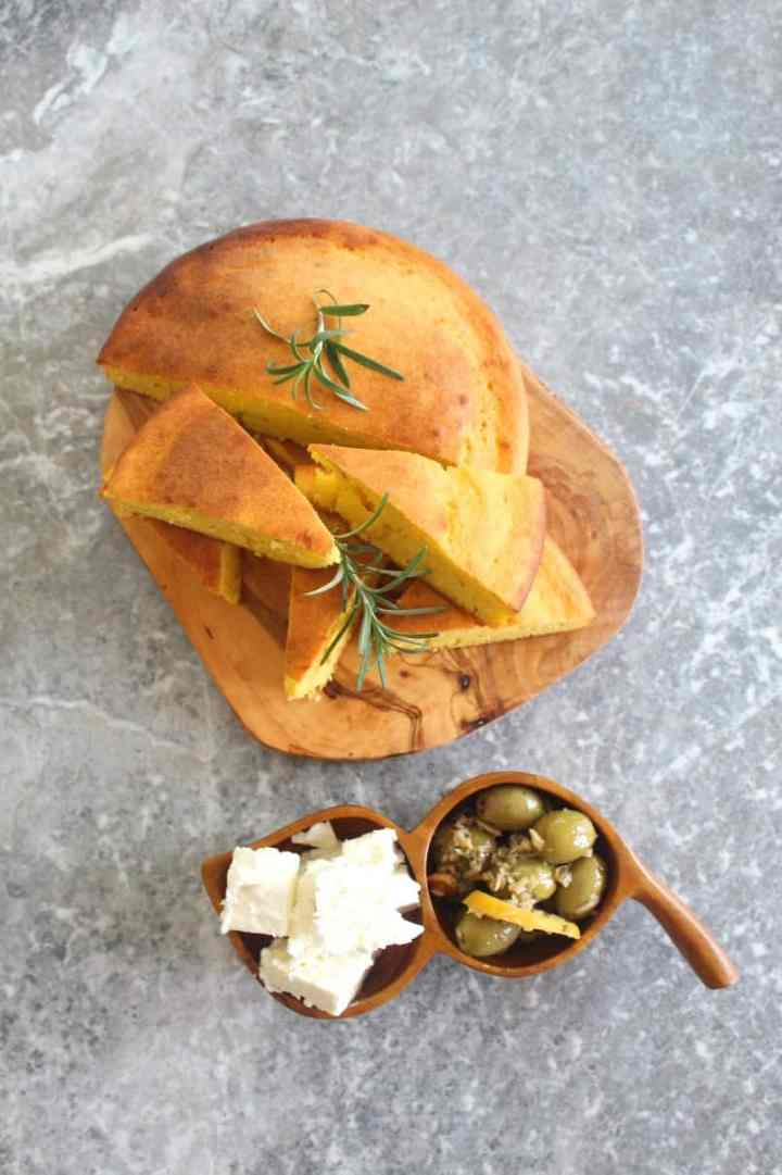 Mediterranean Rosemary Cornbread accompanied with feta cheese and olives.