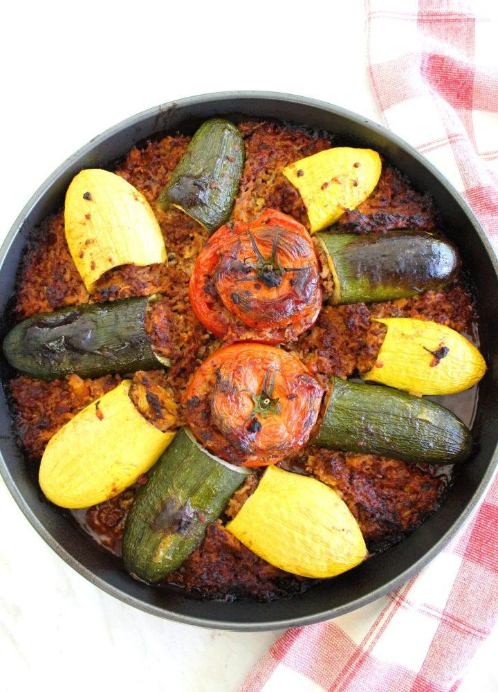 Baked casserole with stuffed zucchini, stuffed yellow squash and stuffed tomatoes.