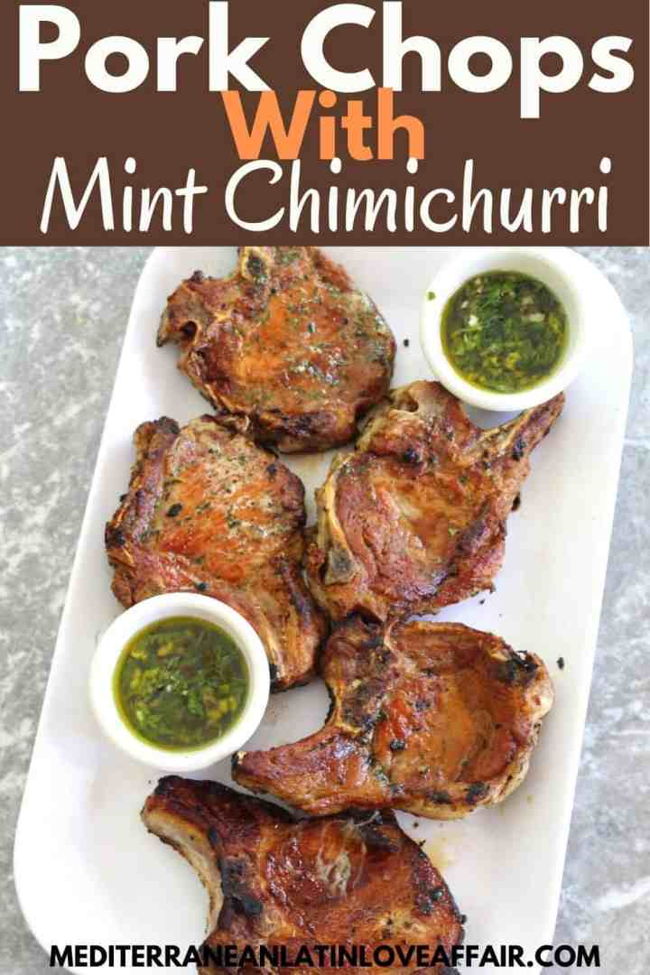 Skillet pork chops with mint chimichurri on a platter.