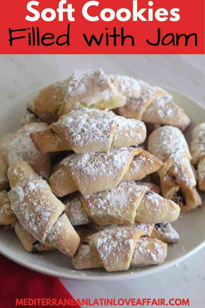 An image prepared for Pinterest. It shows a pictures of the cookies on a plate, cookies are dusted with confectioner's sugar. On top of the picture there's a title bar and at the bottom you see the website link