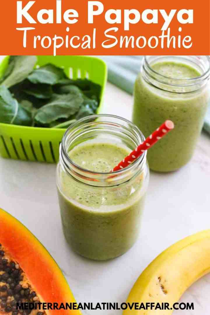 An image prepared for Pinterest, it shows a jar of green smoothie, fresh kale in a container, another smoothie jar in the background, papaya and banana.