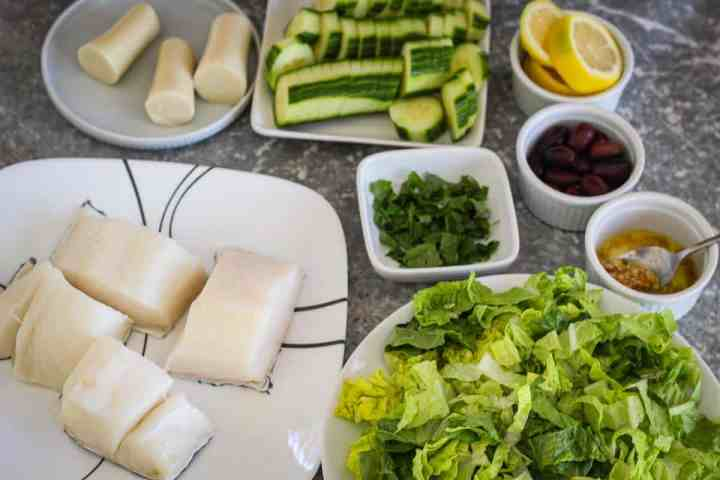 Ingredients for the Chilean Sea Bass: 4 fish fillets, lettuce cilantro, garlic, olive oil, lemon, olives, cucumber, hearts of palm, salt.