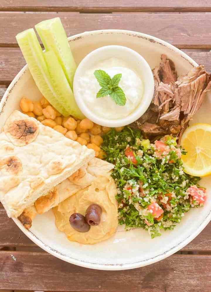 Mediterranean bowl with tabouli, chickpeas, hummus, lemon, lamb and pita!