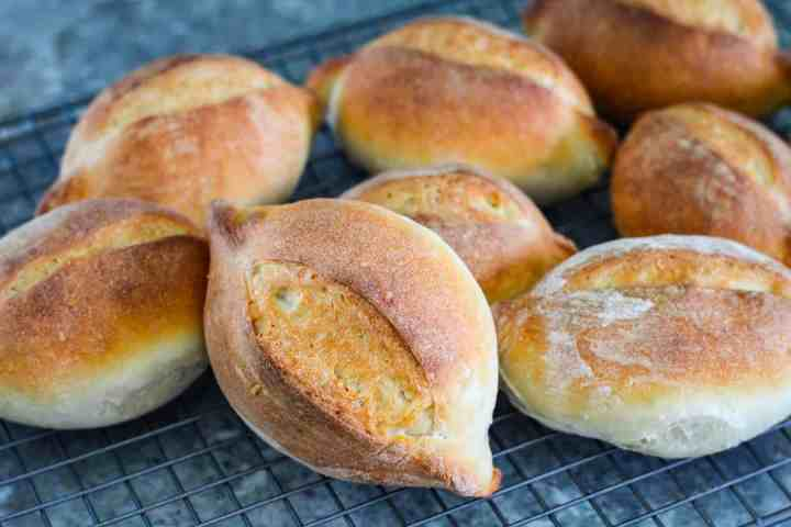 Marraquetas just baked and placed on a cooling rack.