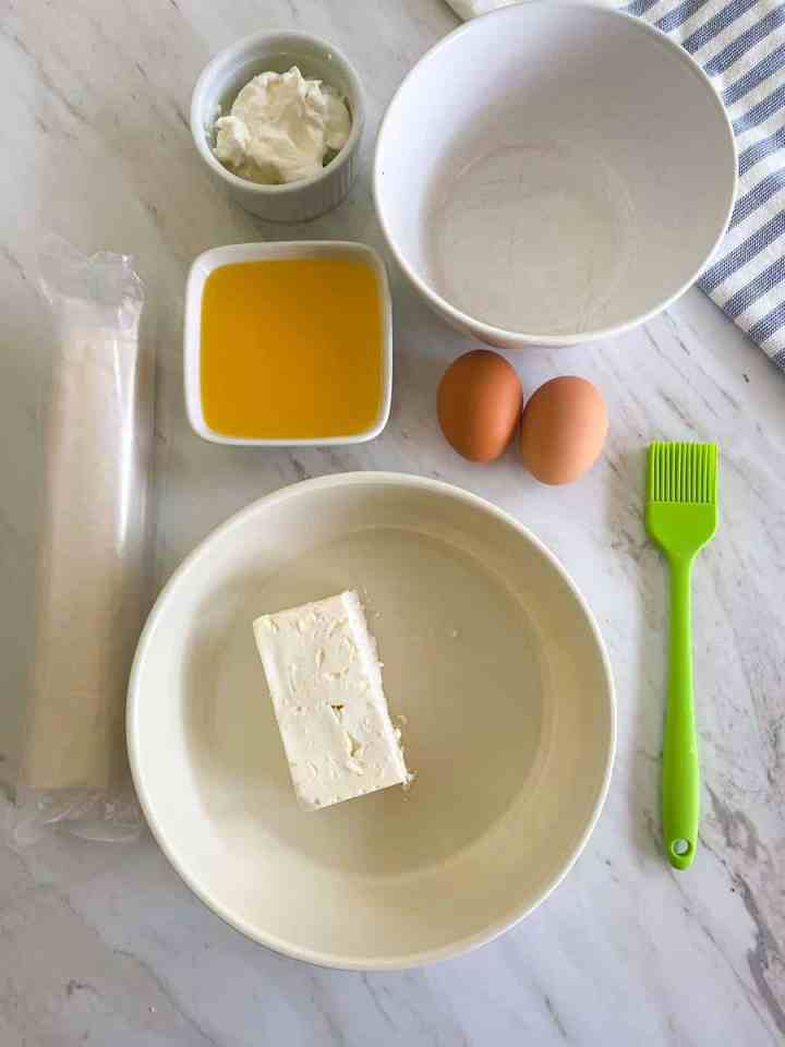 Ingredients for phyllo feta sticks laid out on the the counter.