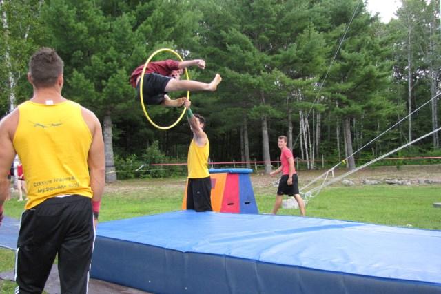 amazed camper jumping through a hoop at circus arts
