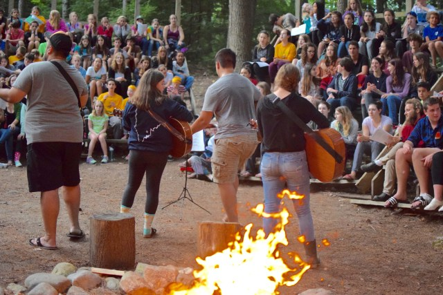 staff singing at the campfire