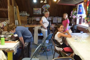 campers working on fabric arts