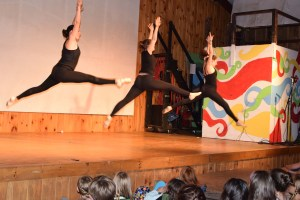 jazz dancers leaping across stage