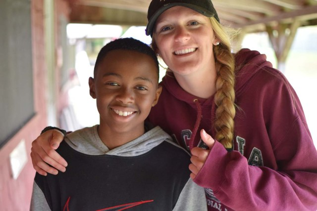 staff member with a camper