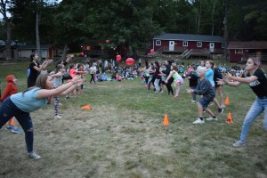 campers throwing water balloons across the field
