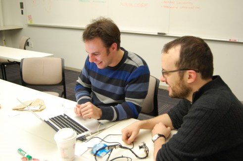 Ned McCague (left) and Matt Doiron (right) work on their eye-tracking device for evaluating concussions. Photo credit: Ajay Major.