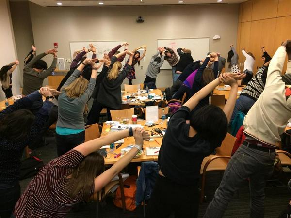 Participants at the Codeathon stretch, breath and exercise. Photo via @MITHackMed.