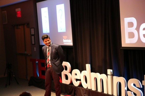 Richie Etwaru, the TedxBedminster organizer, opens up the event with a brief talk. Photo provided by Etwaru.