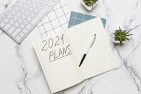 To do list on 2021 year with computer on white background