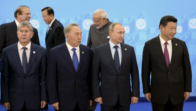 The SCO heads of state, the heads of observer states and governments, and international organisation delegation heads pose for a group photograph during the Shanghai Cooperation Organization (SCO) summit in Ufa, Russia, July 10, 2015. REUTERS/BRICS/SCO Photohost/RIA Novosti