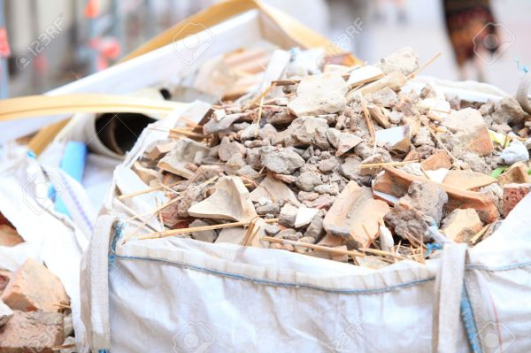 20966792-Full-construction-waste-debris-bags-garbage-bricks-and-material-from-demolished-house-Stock-Photo