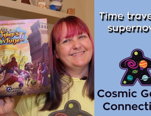 A woman holding A Thief's Fortune game box. Text: Time traveling supernova? Cosmic Game Connections