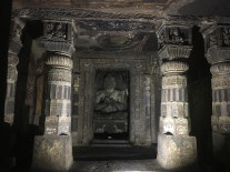 Almost every cave has a similar Buddha figure at the center