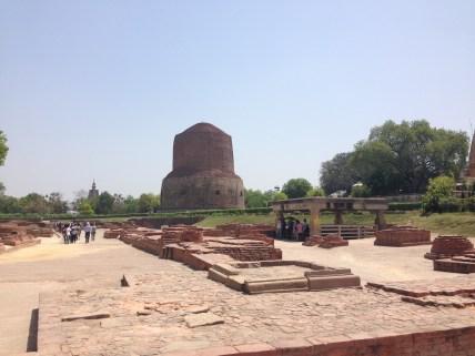Dhamekh Stupa with adjacent ruins