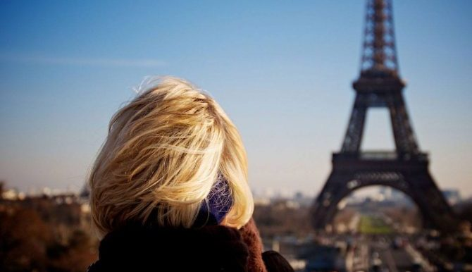 Woman looking at Eiffel Tower