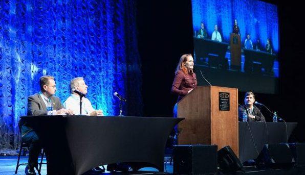 Speaker in front of podium