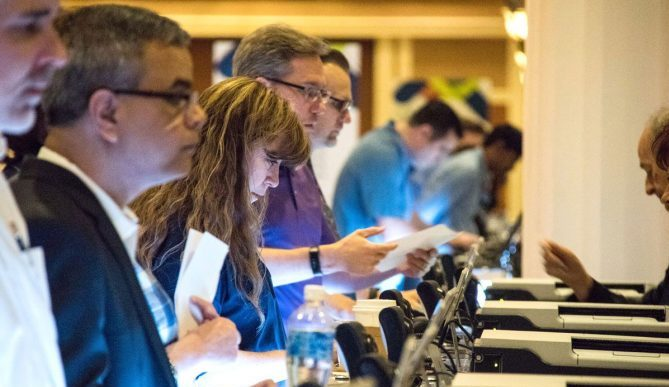 Attendees registering for event onsite