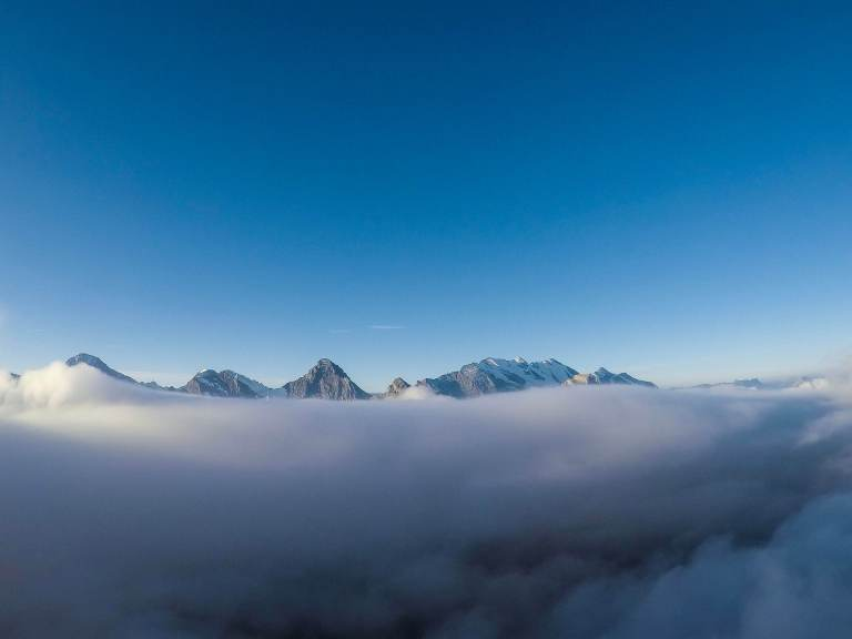 View from Schilthorn, Piz Glloria Switzerland, Clouds cover the mountain range