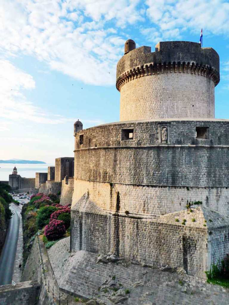Early sunrise on the outside of the City Walls of Dubrovnik showing the turrets and towers