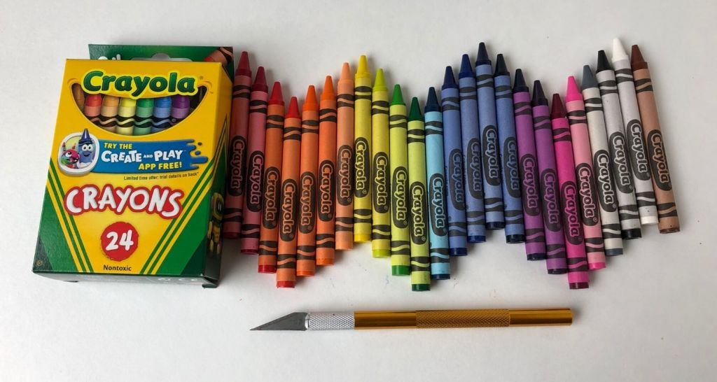 Crayons lined up and prepped for peeling with X-Acto knife