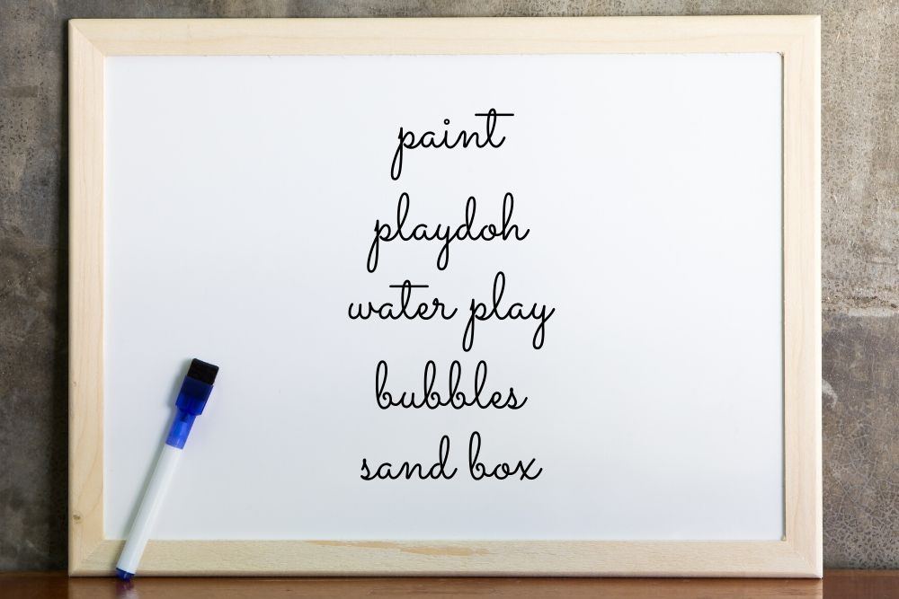 Whiteboard of ideas to keep kids busy while working from home with kids