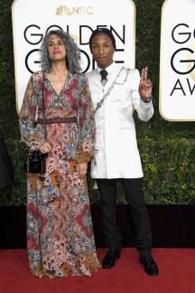Mimi Valdes and Pharrell Williams