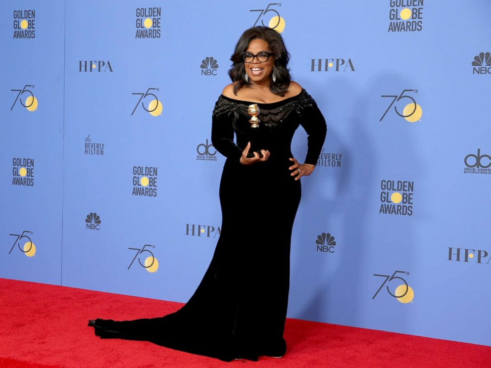 Oprah Winfrey with her Cecil B. Demille award. Photo by Lucy Nicholson/Reuters