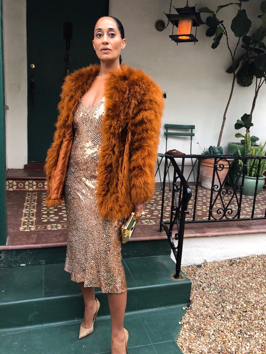 Tracee Ellis Ross heading to the NAACP Image Awards wearing a Narciso Rodriguez gown with a vintage YSL coat and Tiffany & Co. jewlry with Louboutin heels. Photo via Instagram @traceeellisross