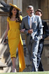 Amal Clooney wearing Stella McCartney and George Clooney
