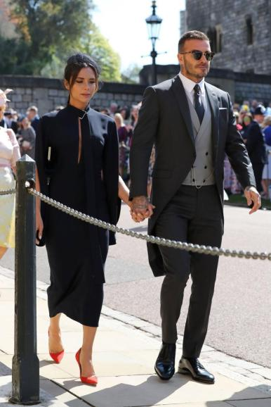 Victoria and David Beckham wearing a Victoria Beckham dress and Dior Homme suit.